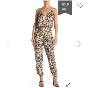 Socialite leopard print romper Size XS